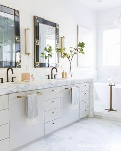 Master bathroom goals. Double marble vanity with gold and black accents Designed by Alice Lane Home Photo by Nicole Gerulat