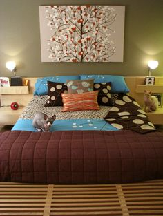 Large art above bed instead of headboard - save space.