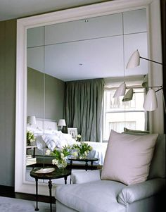 """I've leaned a massive, over-scale mirror against the wall of my bedroom, as I do in so many houses. It's taking an architectural approach to a decorative object — like cutting open a wall onto a space beyond. It's also more casual and interesting to lean something than to hang it. Once a mirror is hung, it's isolated on the wall. But when it leans, the floor runs right into the glass."""" -VICENTE WOLF, INTERIOR DESIGNER"""