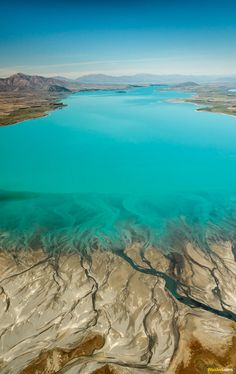 From the air Lake Tekapo appears extra terrestrial in form. A vibrant shade of aquamarine the water looks as though artificially dyed..