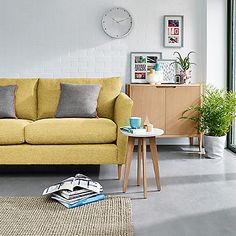 Living room furniture, including a sofa, side table and sideboard