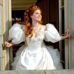 """Enchanted (2007) Amy Adams as Giselle in her Fairytale Wedding Gown: """"oh how strange the world can be ..."""" Wish I had a NYC balcony like this."""