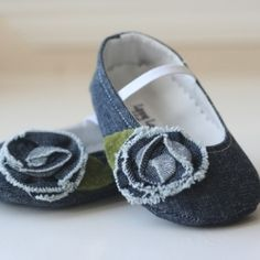 Handmade denim baby shoes with a denim rose on top.