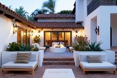 A Malibu Spanish-Style Home With Bold Accents. Patio backyard decor with fire pit Casa Patio, Backyard Patio, Backyard Landscaping, Spanish Landscaping, Backyard Fireplace, Patio Wall, Patio Roof, Modern Landscaping, Outdoor Rooms