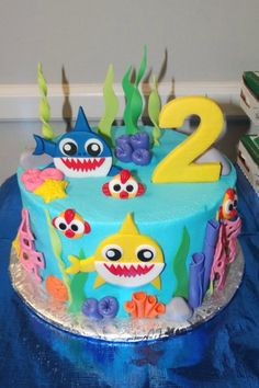 These 12 Fun Baby Shark Party Supplies Are the Best! Shark Birthday Cakes, Birthday Cake Girls, 2nd Birthday Parties, Birthday Ideas, Shark Cake Pops, Anti Gravity Cake, Shark Party Decorations, Giraffe Cakes, Shark Party Supplies