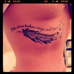 Feather underboob tattoo