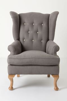 I can see my husband reading in this. It also comes in a rocking chair. Howell Wingback, Linen - Anthropologie.com