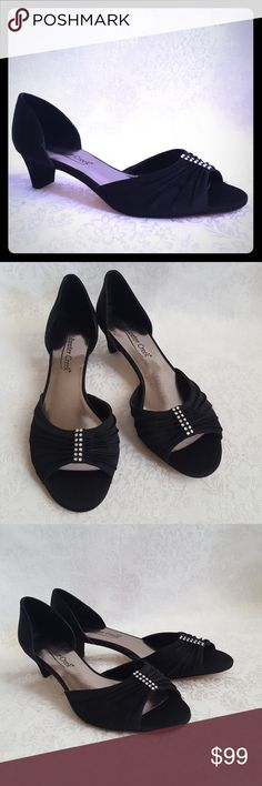 """NWOT Black Silky Heels Rhinestones Coldwater Creek silky black fabric open toes shoes with pleated & gathered top with rhinestones. 1 3/4"""" heels and leather outsole. Perfect evening wear shoe.  New, without tags. Excellent condition.  Smoke free and pet free home.   Check out my other listings - 100's of 👠shoes👠, 👢boots👢 and 👜bags👜. Bundle 2 or more and save money!💲💰💲 Coldwater Creek Shoes Heels"""