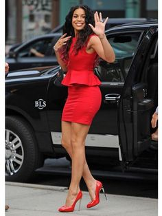 Jordin Sparks in a figure-flattering bright red peplum dress