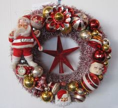 Santa wreath that I made. Lots of vintage ornaments, kitsch and hot glue.