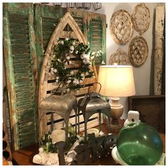 Green and White vignette, with vintage European Chippy green shutters, architectural white chippy architectural wall art, fish floats, galvanized lanterns, white dough bowl, and cotton wreaths. Green Shutters, Cotton Wreath, Dough Bowl, American Decor, Vignettes, Ladder Decor, Lanterns, Rust, Wreaths