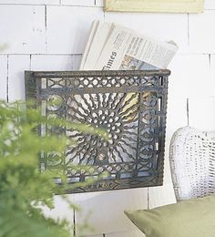 ornate metal heating vents as wall-mounted racks for newspaper or magazines.