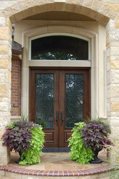 I like the archway, the window above and the scroll hardware on the doors Arched Front Door, Front Door Plants, Double Front Entry Doors, Iron Front Door, Front Door Entrance, Door Entryway, House Front Door, Front Door Colors, Glass Front Door