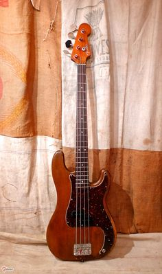 This Fender Precision Bass was made in the USA in 1966. This bass is refinished and all the parts are changed.