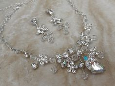 This beautiful handmade necklace and earring set is a symphony of swarovski crystals and glass rhinestones.  Has a Tiffany blue stone incorporated in it's design to act as the Brides something blue item on her Wedding day.