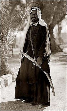 Bedouin Sheikh.  A sheik is the head of a tribe. He is often the wealthiest member of the tribe and may posses more than a thousand camels. Among the important criteria in choosing a leader are age, religious piety, personal qualities, generosity and hospitality.