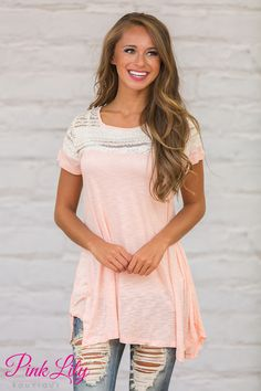 This sweet lace blouse is such a beautiful way to transition between summer and fall! (And we won't say a word if you hang onto this gorgeous look for spring, too!) We adore the lovely ivory lace on the top of the blouse paired with a soft and lightweight heathered pink material - it is so feminine and sweet!