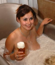 The weird czech beer bath. Czech out the perfect head on that beer. ( and her boobs are nice too)