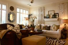 "there isn't a room in this house that doesn't speak ""cozy and welcome""...traditional living room by Shannon Malone"