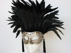 absolutely adore the shapes of the feathers, the tassels, the simple silver against black
