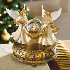 Keep the reason for the season uppermost in your mind with this stunning musical globe. Two beautiful angels are cradling a snow globe that holds the baby Jesus. Turn the key in the base and it plays ...