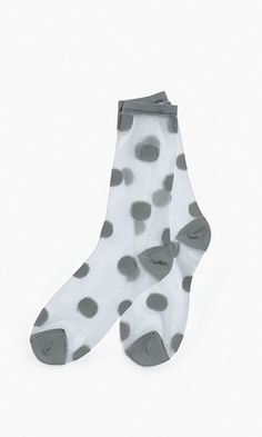 A small update with a big statement: classic spots and sheer nylon instantly transform your entire look.