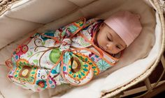 A baby in a swaddle blanket- this would be great made with Embrace for summer or Cuddle for winter!