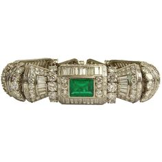 Take a look at this Spectacular French Art Deco Approx. 58.0 Carat Multi Cut Diamond, 12.0 Carat Colombian Emerald and Platinum Bracelet. Highest quality stones throughout. Diamonds E-F color, VVS-VS clarity. Emeralds with vivid saturation of color. Stamped (indistinctly) to clasp. Very finely made from1906,