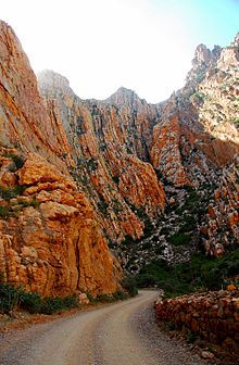 The Swartberg Pass on the R328 run through the Swartberg mountain range (black mountain in English) which runs roughly east-west along the northern edge of the semi-arid area called the Little Karoo in the Western Cape province of South Africa.