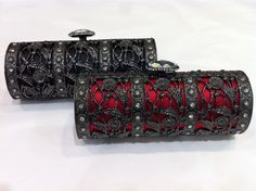 Antique inspired Red and black satin and metal clutch bags by Drap Barcelona.