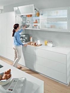 Not+only+is+the+color+of+kitchen+cabinets+changing+—+hardware+manufacturers,+like+Blum,+are+changing+the+way+cabinet+doors+and+drawers+function.+These+hydraulic,+easy-close+doors+fold+up+and+out+of+the+way+with+the+touch+of+a+button+making+them+perfect+for+kitchens+where+space+is+an+issue.+Image+courtesy+of+Blum+