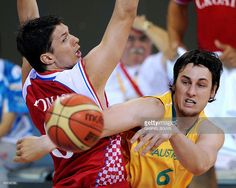 Andrew Bogut (R) from Australia out-passes Marko Tomas from Croatia in a men's…