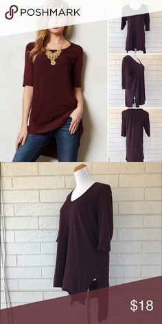 Left of Center Anthropologie Burgundy Hi Lo Tee 3/4 Sleeve Tunic tee from Anthropologie. Hi-low design with a slit in the side. Works great with leggings! Great condition. Anthropologie Tops Tunics