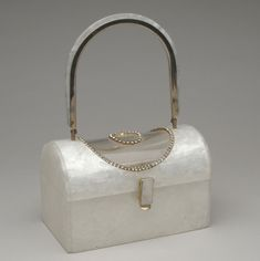 1950s, America - Woman's Plastic Handbag by Tyrolean, New York - Pearlized and clear acrylic, rhinestones, metal