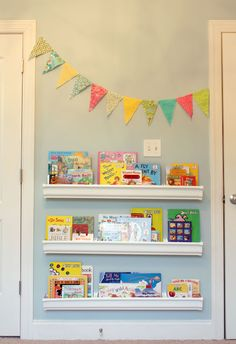 rain gutter book shelves - maybe 1 or 2 over the head of the bed for bedtime stories?