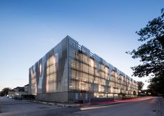 Angled stone surfaces create zigzags across the facade of this hospital building in Copenhagen by Danish firm 3XN