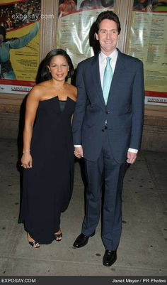Susan Rice, who lied about Benghazi on 5, yes, 5 Sunday news programs after the 9/11/12 slaughter, and is now National Security Advisor to Obama, a post for which she did NOT need Congressional approval. She would never have been approved by Congress. The stalk on her right is her husband Ian O Cameron.