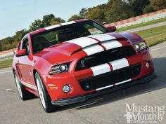 Mustang Monthly-In addition to its 662-horsepower, the Mustang Dream Giveaway '13 Shelby GT 500 has been treated to a special Candy Apple Red paint job to match the '68. Enter to win at: http://www.winthemustangs.com. Promo code: TP0513M for DOUBLE Tickets.