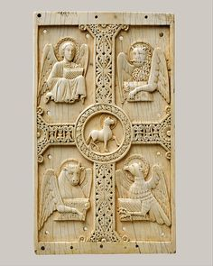 Plaque with Agnus Dei on a Cross between Emblems of the Four Evangelists, South Italian.Date: 1000-1050. Ivory.