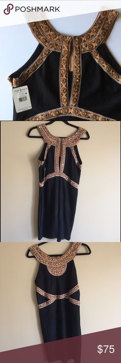 """NWT Free People Dress w/ Embroidery details Size M This is an eye catching short dress by Free People. Beautiful mirror & stunning embroidered details.  Crew neck Side zip closure Sleeveless Back keyhole with hook-and-eye closure Embroidered and embellished detail Approx. 33"""" length 72% polyester, 22% viscose, 6% spandex Care Hand wash cold Free People Dresses Midi"""