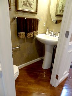 Small Narrow guest toilet in hallway. All that is needed. Should fit with the…