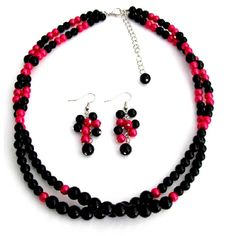 Price $12.99   Wedding Jewelry in Magenta & Black pearls Two strand twisted necklace with cute dangling pearl at the back of necklace extension. Very cute grape style dangling Earrings in two colors Magenta & Black pearls. It is fabulous! It boasts a ton of flawless & luminous pearls Two strands twisted statement necklace & earring would be gorgeous jewelry.