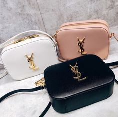 Yes, Saint Laurent is expensive. But a Saint Laurent piece (the company has since re-branded and dropped the 'Yves' in a move to stay modern) is an investment. Luxury Bags, Luxury Handbags, Purses And Handbags, Designer Handbags, Designer Bags, Ysl Handbags, Blue Handbags, Yves Saint Laurent Tasche, Dior