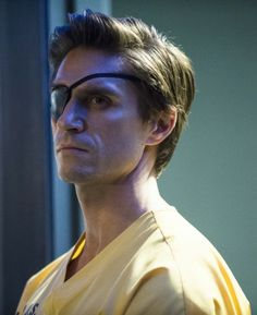 """Arrow -- """"Suicide Squad"""" -- Image -- Pictured: Michael Rowe as Floyd Lawton (""""Deadshot"""") -- Photo: Cate Cameron/The CW -- © 2014 The CW Network, LLC. All Rights Reserved. Meet The Team, A Team, Michael Rowe, Floyd Lawton, Amanda Waller, Al Ghul, Dc Tv Shows, Deadshot, Dc Legends Of Tomorrow"""