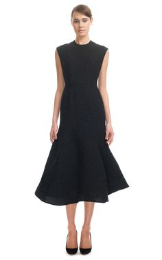 Vika Gazinskaya | Sleeveless tweed dress featuring a high round neck, an A-line silhouette, and a sculpted fit-and-flare skirt