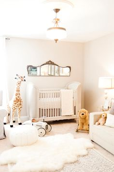 Our Dreamy Parisian Nursery Decor french nursery, nursery decor, interior design, nursery design, chandelier, Restoration hardware, giraffe, RH baby, pottery barn, pb kids, sheepskin rug, pouf, vintage mirror, belle crib, comfort glider, vilac car, french, the animal print shop, melissa and doug, safavieh, wayfair, baby, Britt Taylor Photography