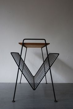 modernist/minimalist Magazine Rack - with a teak top and wire frame