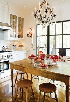 love the antique pine table and chandelier