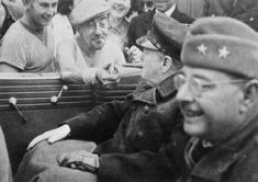 A newly liberated French citizen happily lights Winston Churchill's cigar (1944).