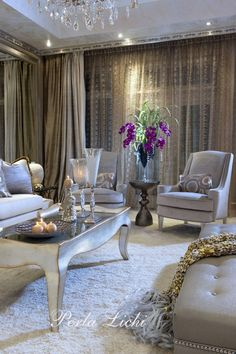 Glamorous accents make a stunning statement in this living room completed by @perlalichi. #luxeFL